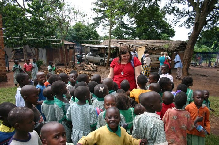 Jessica with student in Uganda. ALL Paper Bead necklace Proceeds fund education in Uganda